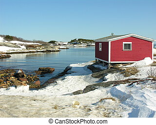 red stage 1 - red shed on shoreline on beautiful sunny day...