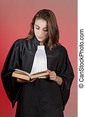 Young law school student reading a statute book
