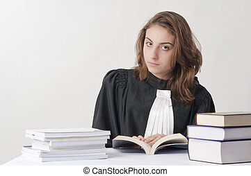 Young law school student studying from her statute books