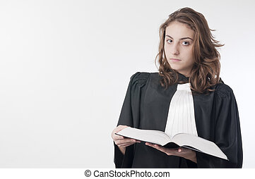 Young lawyer - Young law school student holding the statute...