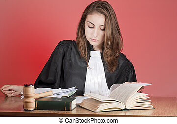 Young lawyer - Young law school student reading from the...
