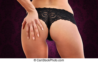 Hot ass - Close-up of female bottom with black panties