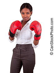 Young black woman wearing boxing gloves - Young African...