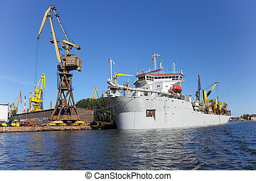 Dredging ship berthed at the wharf port in Gdansk, Poland