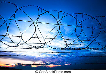 barbwire - sunset behind the barbed wire - fence with sunset...