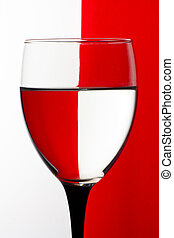 Wine glass refraction - Wine glass with red and white...