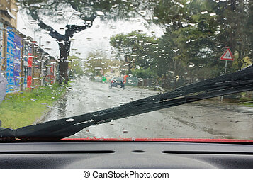rain on the road - looking through the car windshield in the...