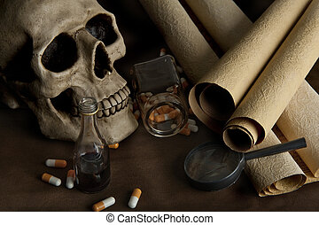 Science - Scientific still life with skull, old documents...