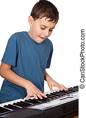 Boy playing piano - Cute kid playing piano, isolated on...