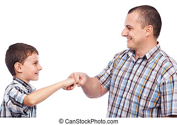 Father and son with a kind of high-five salute - Father and...