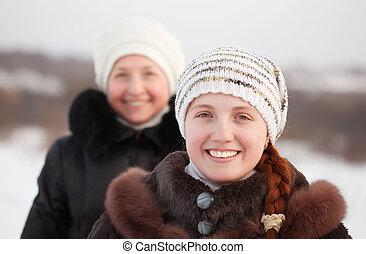 happy women in winte - Portrait of two happy women in winter...