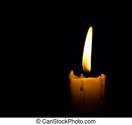 candle flame over black background with copyspace