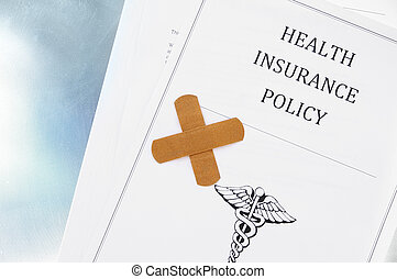 health insurance policy with bandage, shot from above