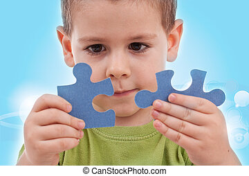 Boy with puzzles - Boy connect puzzles - blue background