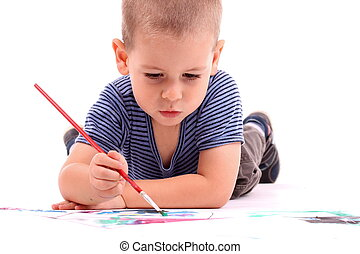 boy painting - young boy painting over white