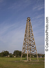 Wooden Oil Derrick - Historical Spindletop style old wooden...