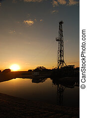 Sundown at the Derrick - The drilling does not stop at...