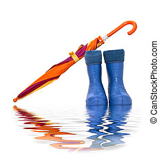 rubber boots and a colorful umbrella with reflection in...
