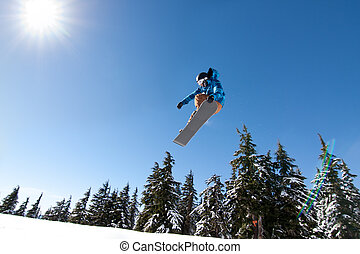 Male Snowboarder Catches Big Air. - Male Snowboarder Catches...