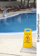 Caution wet floor near pool - Caution about wet floor near...