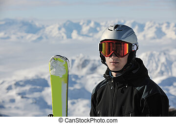 skiing on on now at winter season - young athlete man have...