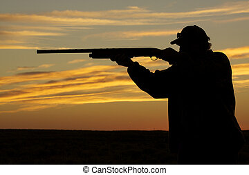 Upland Hunter Shooting in Sunset