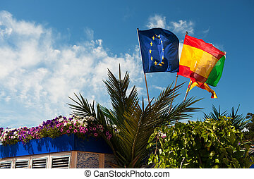 Spanish coast with flags