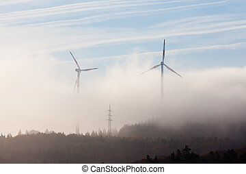 Wind turbines in fog - Ghostly shapes of large wind turbines...