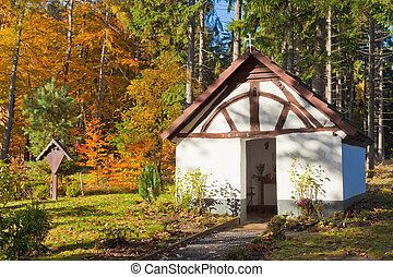 Historic Chapel in fall forest, Eifel, Germany - Historic...