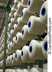 Yarn Bobbins - Yarn cone mounted in a fabrics factory