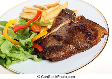 steak with salad and fries