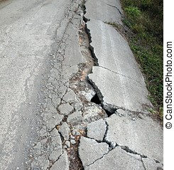 Heavily Damaged Road - A narrow road has been damaged by an...