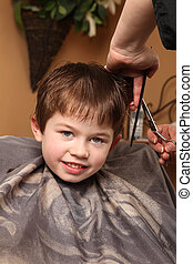 haircut - cute young boy getting a haircut
