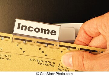income word on business folder showing finance financial or...