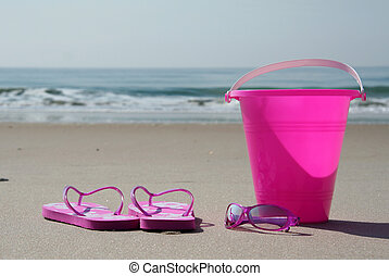 Flip-flops, sunglasses and pail on the beach - Flip-flops,...