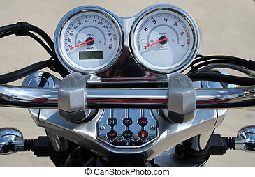 Motorcycle handlebar controls including speedometer and...