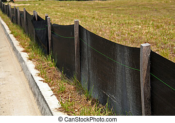 Erosion control barrier at a construction site.