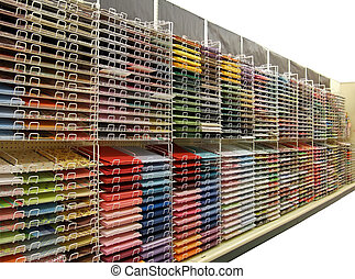 Colorful craft or scrapbook paper on shelves - Isolated -...