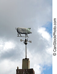 A pig shaped weathervane.