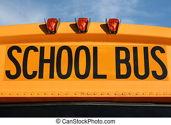 Yellow school bus sign - Close-up view of a yellow school...