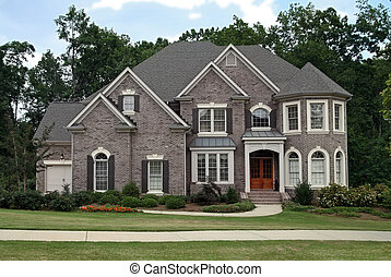 Upper class luxury home with intricate stonework and brick