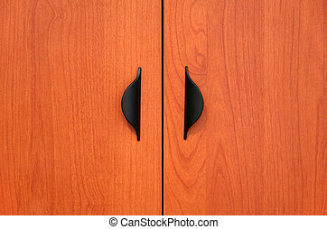 Wooden cabinet doors with black handles