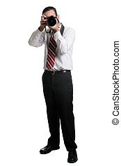 Photographer - A full length view of a photographer using a...