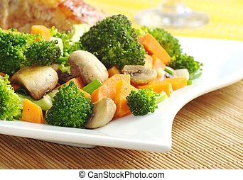 Fried vegetables (broccoli, mushroom, carrot, shallot) on...