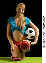 Sexy female soccer player with ball