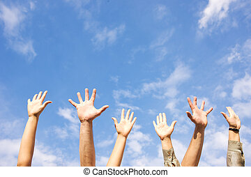 Hands rised up in air across sky - Hands rised up in air...