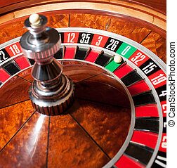 Roulette with ball on zero - Close up of roulette with ball...