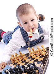 Children playing chess - Childre playing with chess in white...