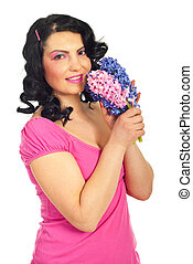 Beauty woman in pink with fresh hyacinth