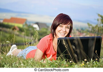 woman using laptop - Beautiful young woman using laptop at...